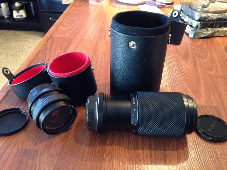Lot of 2 Underground Pentax k mount lenses 28mm f2 8 and 80 - 205mm f4 5  zoom macro lenses both look ok both not tested  2 leather? cases