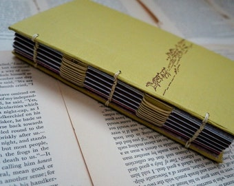 Journal, sketchbook, hand-bound with vintage book covers from a 1961's Children's Western Novel