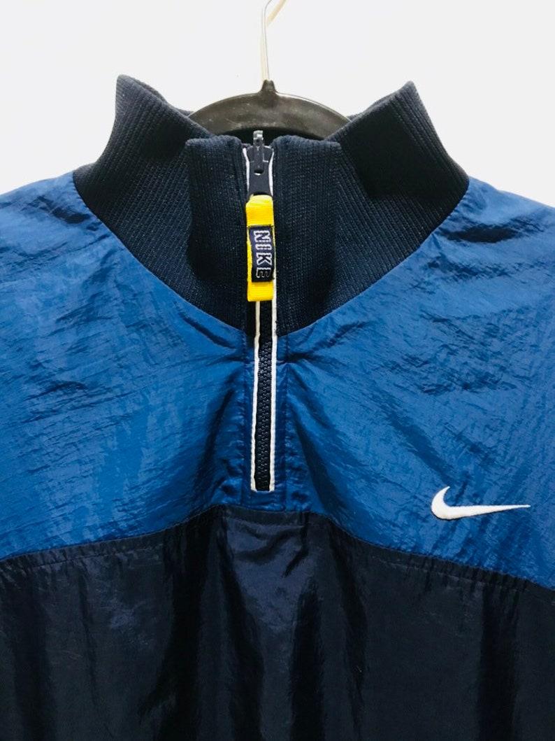 29d71808a 90s vintage reversible reflective Nike windbreaker