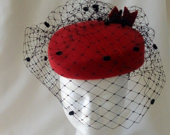 red felt hat with black spotted veiling