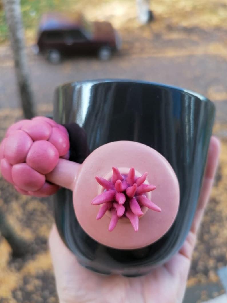 Ceramic mug with Plumbus