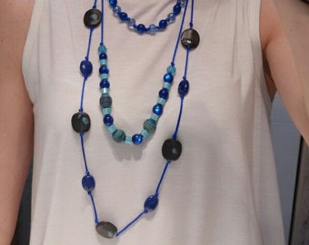 Tripe Collar back in blue, with beads of various materials and knotted