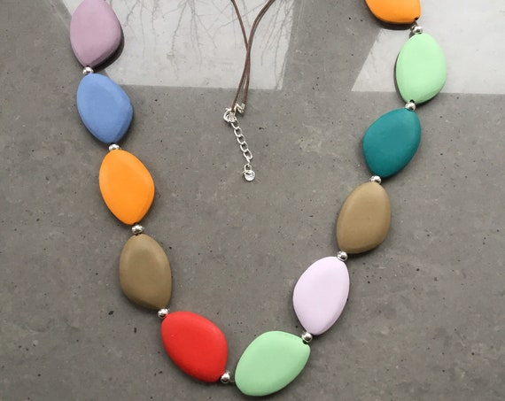 Long lagenlook necklace, with multi coloured oval discs, with double black suede thread.