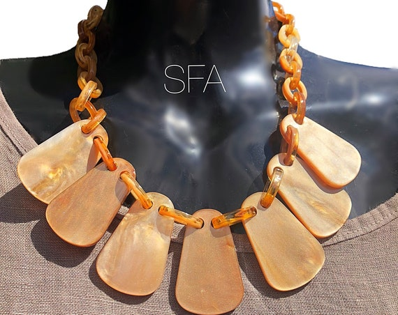 Stunning Acrylic necklace in marbled shimmering gold tortoise shell, with lobster clasp.