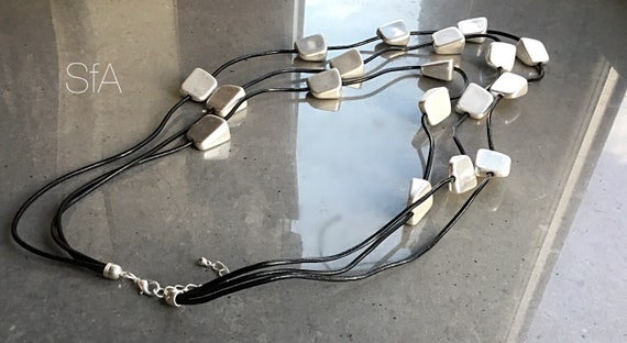 Lagenlook quirky, multi thread cubed shapes, on 3 tiered long leather thread, with extension chain.
