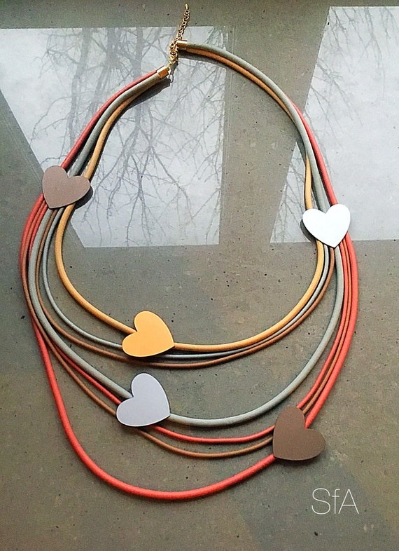 Lagenlook. Rubber necklace, long multi thread, with hearts. Wow factor, quirky, fun.