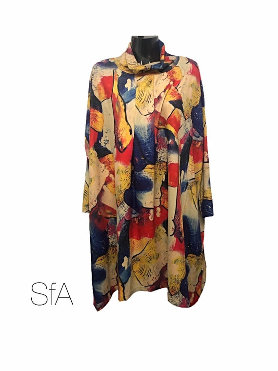 Stunning lagenlook quirky dress, Bella blue, with cowl next and multi coloured pattern. Super soft fleece feel. 2 XL, 3XL, 5XL