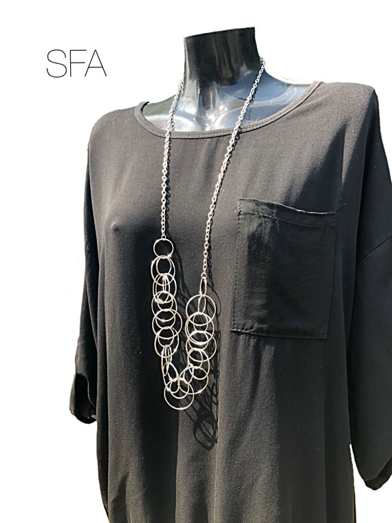Stunning long necklace, inter looped different sized circles, geo chain, in silver alloy.