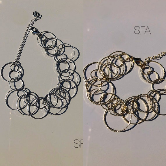 Geo lightweight circles bracelet, in either gold or silver tone alloy. One size fits all with lobster clasp.