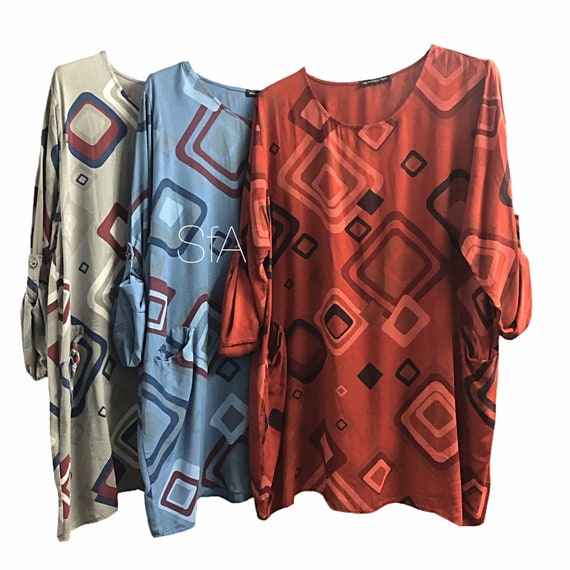 Tunic with geometric shapes, with pockets, turn up sleeves, that drop to long. Size 12, 14, 16, 18 size 2XL