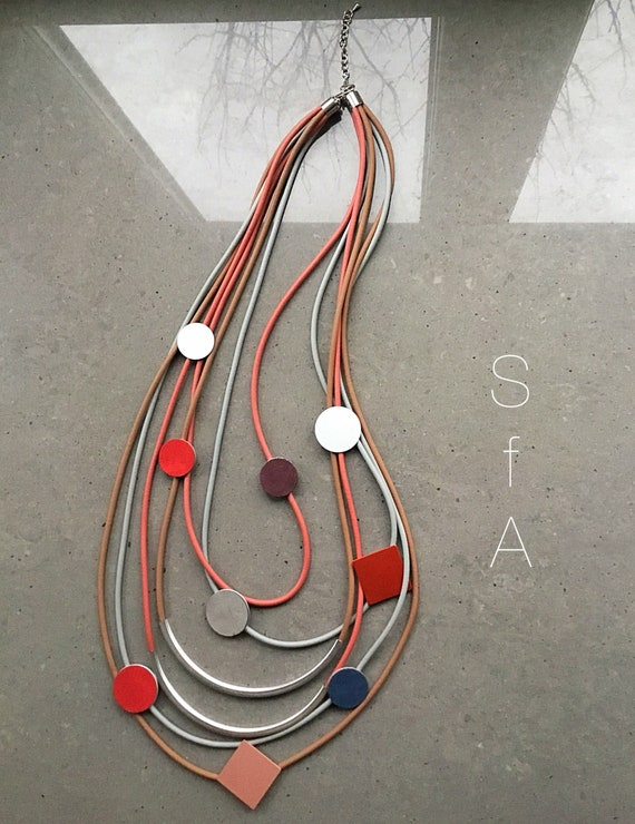 Lagenlook. Rubber necklace, long multi thread, with abstract shapes. Wow factor, quirky, fun.