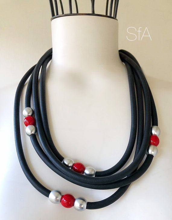 Rubber necklace, short multi thread, in black with red and silver beads.