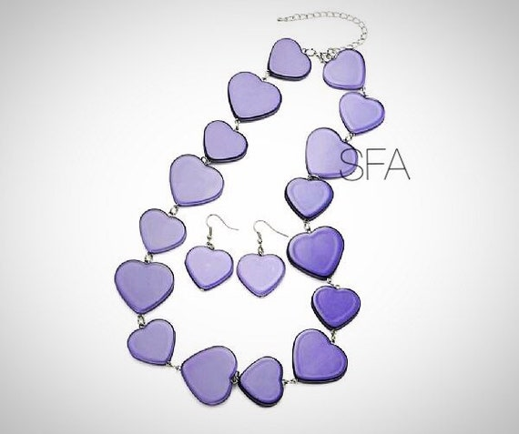 The Lila deap violet or vintage green acrylic heart earrings and necklace.
