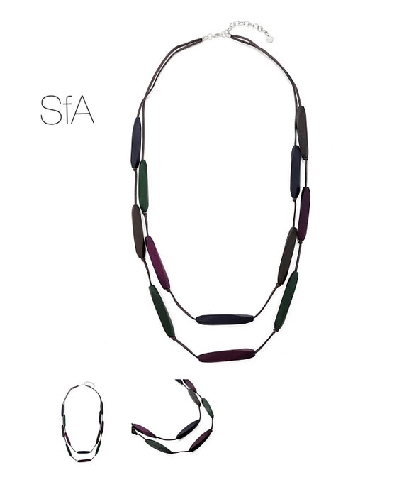 Long necklace made from purple, brown and green wooden cones, with double suede thread.