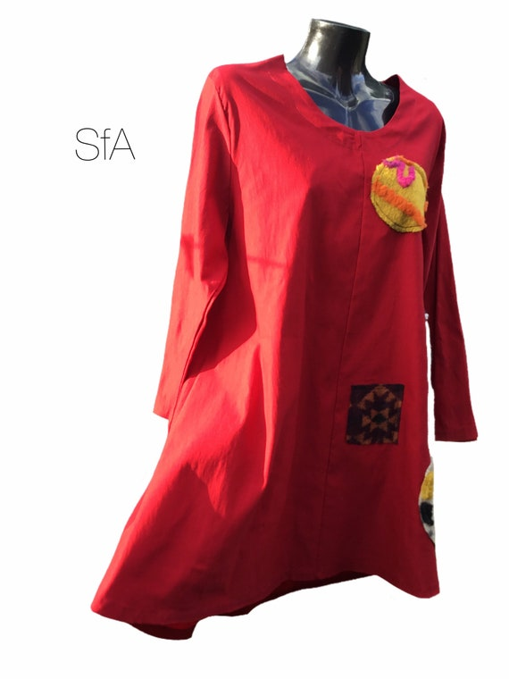 Lagenlook tunic, with fluffy, furry, applique designed. Size, 12, 14, 16, 18. Super stretchy. Size 2XL