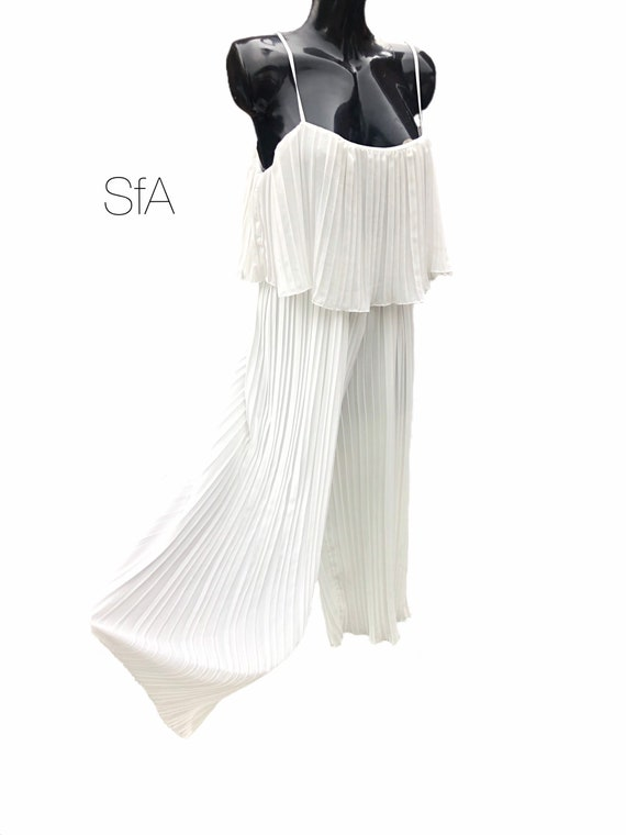 White pleated playsuit, with flounce top and adjustable straps