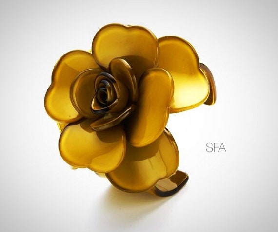 Stunning Pamela acrylic statement piece, flower bangle in muted gold, expandable.