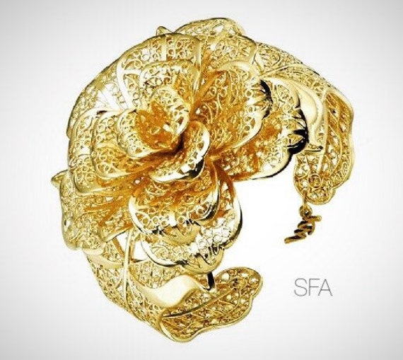 The Alexis gold plated flower bangle, adjustable