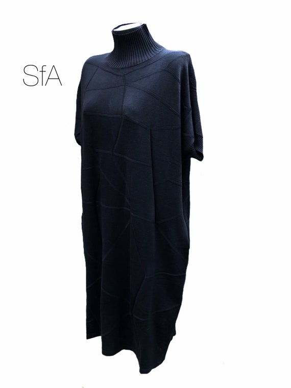 Black dress by Neslay. In black with turtle neck, short sleeves, perfect with boots or heels XXL