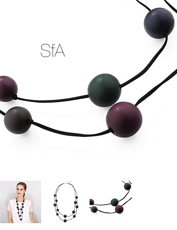 Lagenlook, double row wooden balls, in green and purple, faux suede, rubber strands.