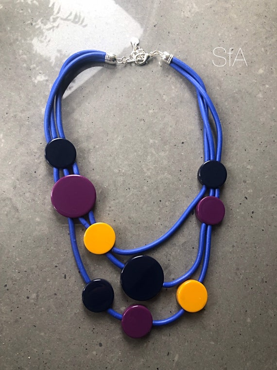 Rubber necklace, electric blue multi strand, with acrylic polished discs.