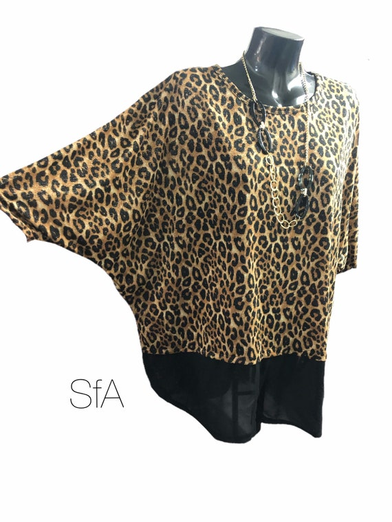 Leopard print tunic top, with shear black trim and free necklace