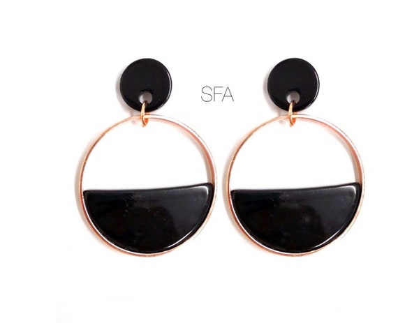 Geo black acrylic earrings. Surrounded in gold, for pierced ears