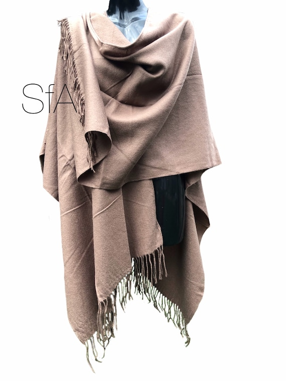 Long tassle shawl, with split neck and long drop. In 3 different colours.