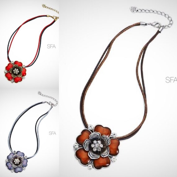The Fluer enamel flower necklace, on a multi strand 2 tone cord thread, in red, vintage lilac or honey brown