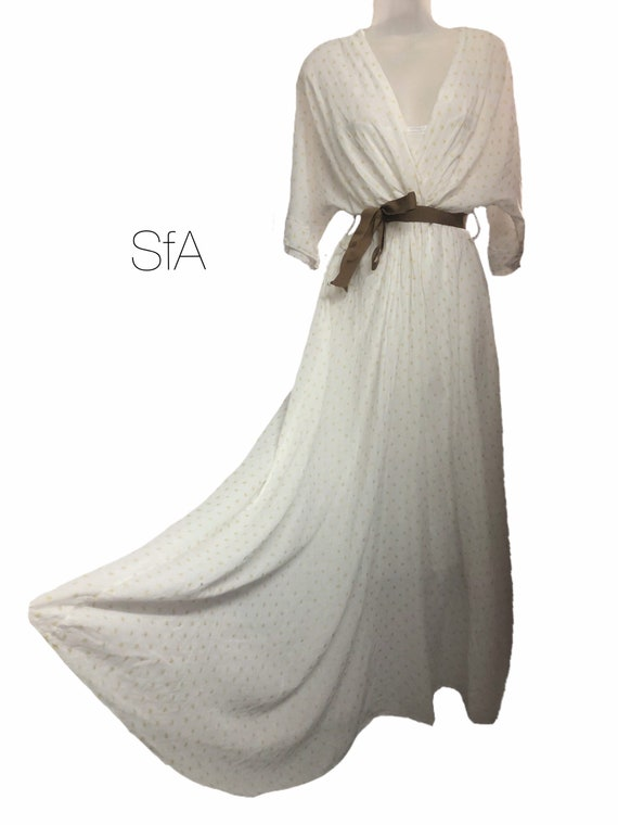 Cotton star maxi dress with full petty coat linning, available in 4 colours. Size 8-12 uk