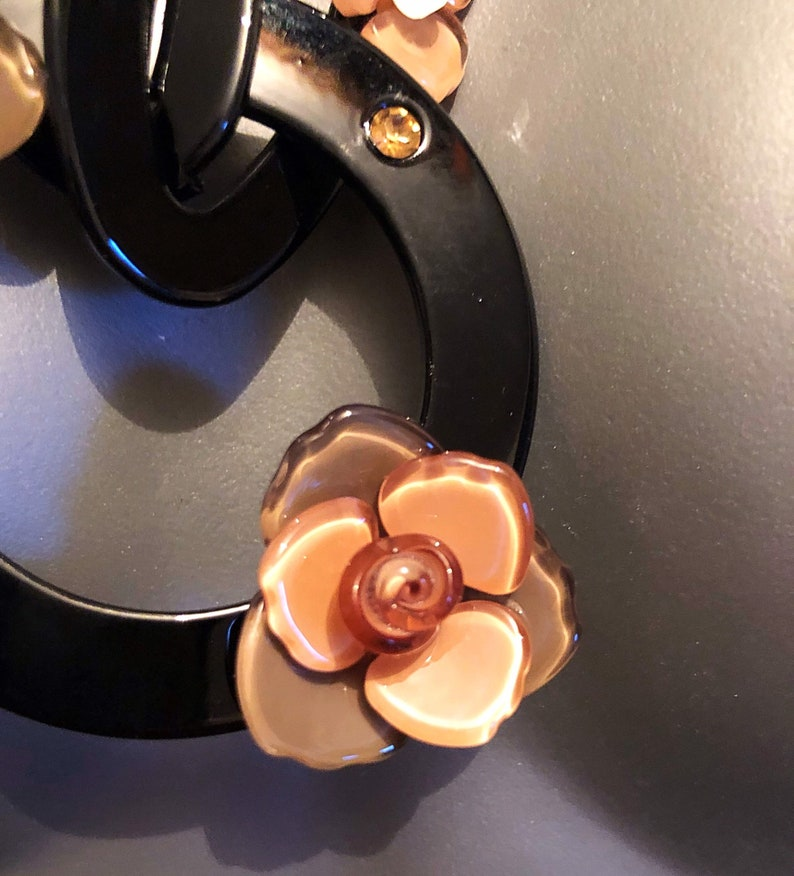 The Leila acrylic black and taupe flower acrylic circular necklace with ribbed ribbon tie