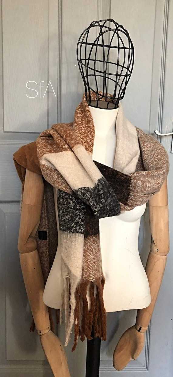 Fabulous panel blanket scarf, super soft, perfect present. In caramel, black and winter white. Fabulous long tassels.