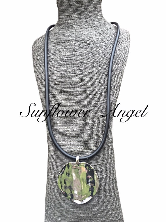 Large lagenlook stainless disc on long thick black rubber cord, lobster clasp.