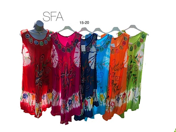 Fabulous floaty hippy chic flower sun dress or tunic, with embroidered front panel. In 6 different colours regular and plus size.