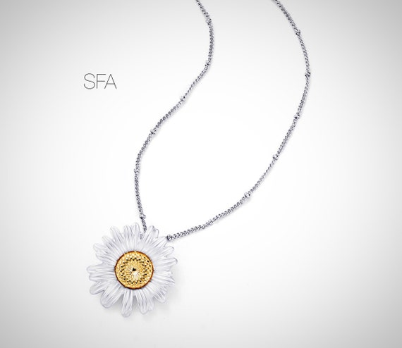 Sunning daisy necklace in frosted silver or frosted deep coral, rose gold. With co-ordinating chain.