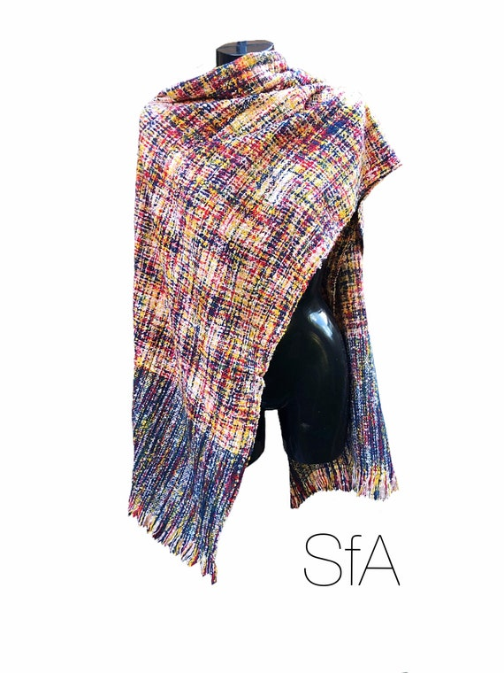 Multi coloured loose weave long scarf. With tassels, very soft, made from acrylic.