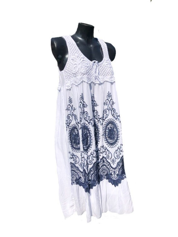 Blue and white sun dress with crochet back, and embroidered front, lined, size 12-16 UK