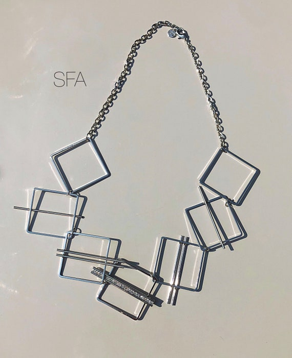 Geo metric necklace, lagenlook necklace, in silver tone. With diamate strip, in either squares or circles. Mid length