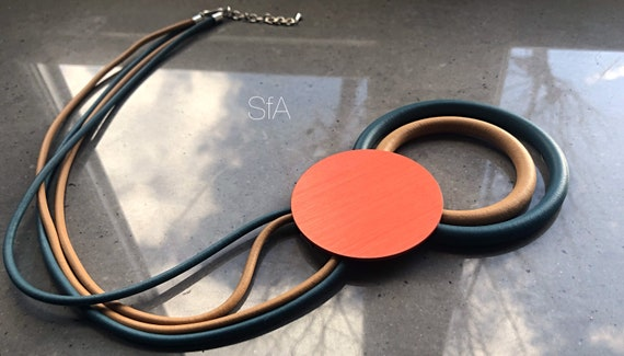 Rubber necklace, lagenlook statement. Caramel and teal threads with large orange disc.