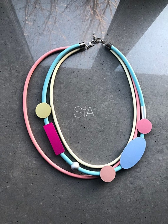 Lagenlook, geo, quirky rubber necklace, medium length multi thread, in cream,pink and blue thread, with frosted discs.