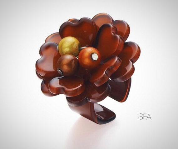 The Sofia acrylic statement ring. With central loose berry beads, fabulous statement piece
