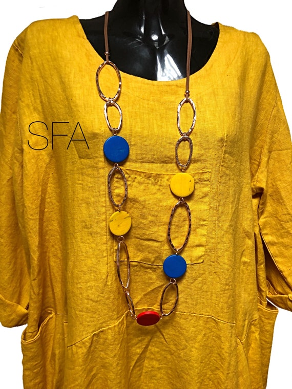Lagenlook colour wooden discs with large dented gold links multi strand necklace.