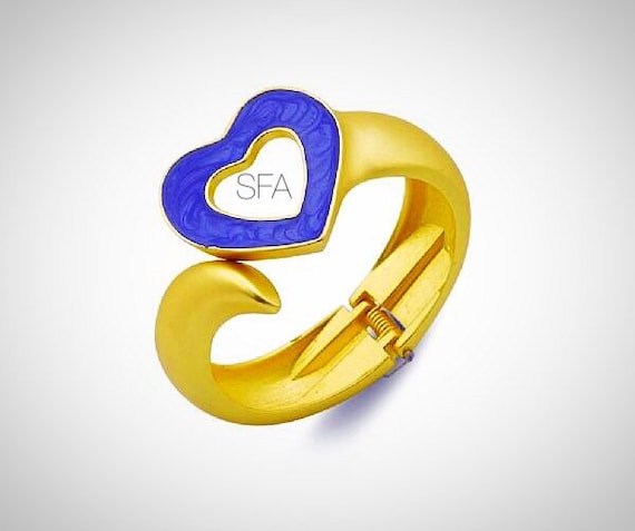 The Cleo gold frosted bangle. Heart shaped blue enamel cuff, Spring fastener