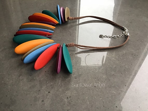 Lagenlook necklace, row of rainbow tear shaped wooden discs. On a double brown sude cord.
