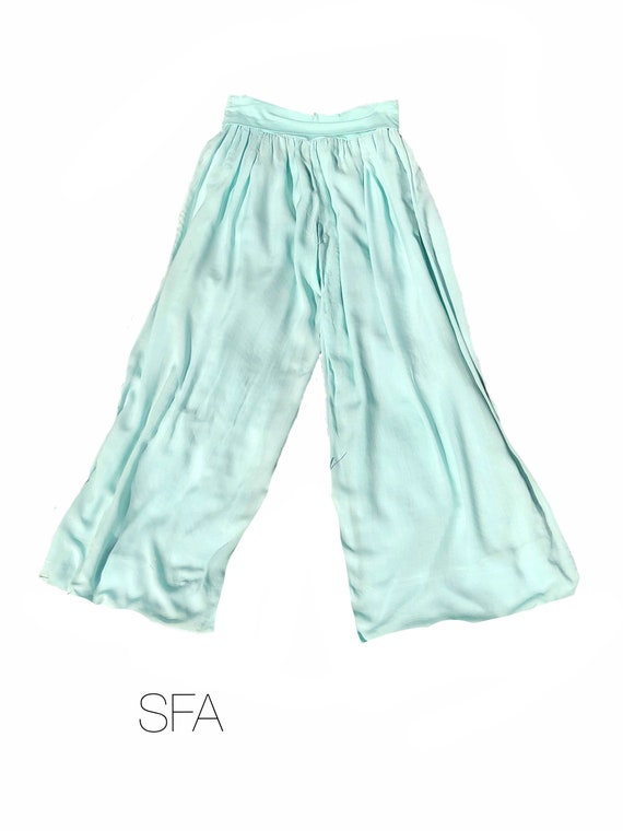 Fabulous palazzo harem pants with wide stretch waist band, in 5 colours, white, cream, beige, blue, black and mint green.