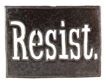 resist, political art, recycled metal art, oil drum, recycled oil drum, metal decor, recycled decor, outdoor art, steel drum art, fair trade