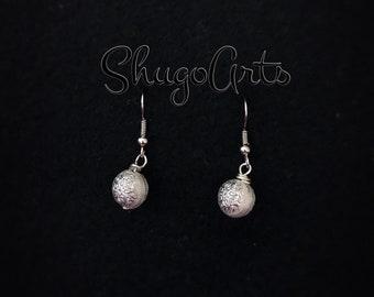 Silver little star earrings