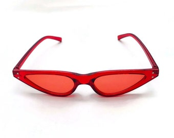 522eefaa80 90 s Narrow Red Tinted Sunglasses Women Cat eye Sunglasses Translucent  Frame Matrix Future Small Rivet