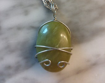 Olive New Jade, wire wrapped cabachon.