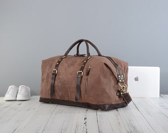 40b9c7d9f7 Personalised waxed canvas and leather holdall bag in brown